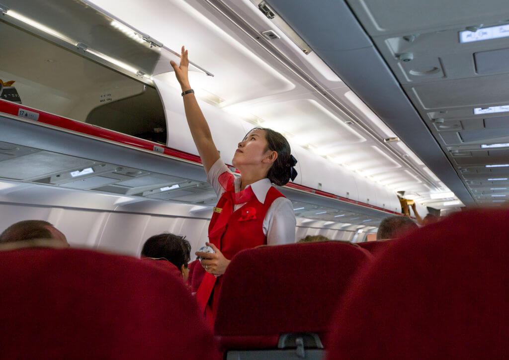 Flight attendant inside an air Koryo tupolev plane, Pyongan Province, Pyongyang, North Korea