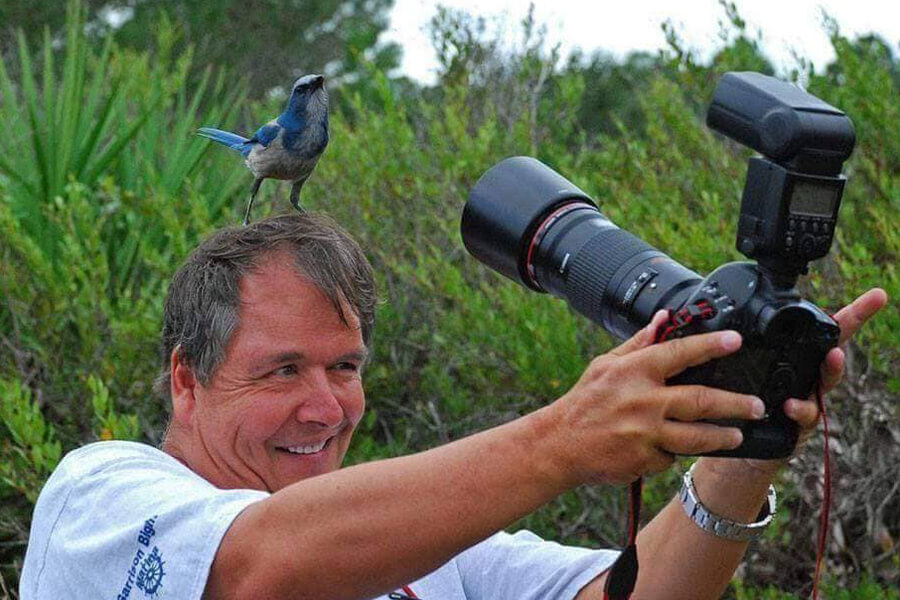 bird on photographers head