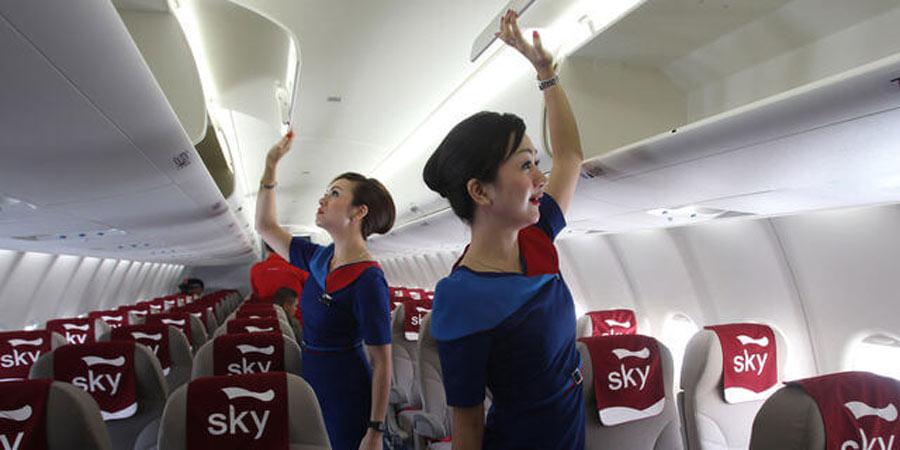 Flight attendants checking cabins