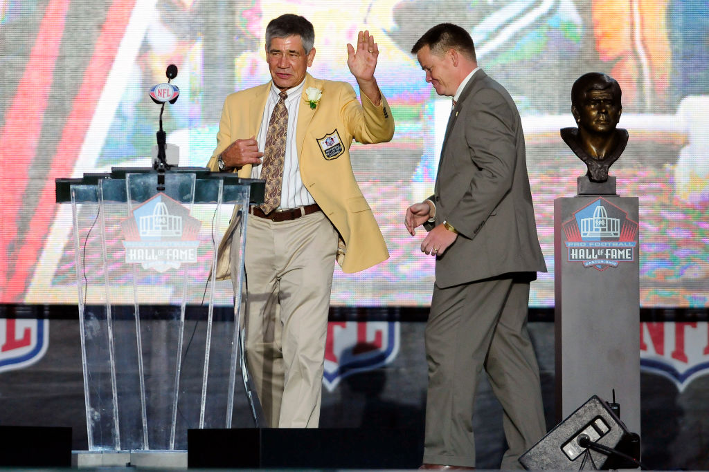 CANTON, OH - AUGUST 6: Former Washington Redskins linebacker Chris Hanburger waves to the fans after the unveiling of his bust at the Enshrinement Ceremony for the Pro Football Hall of Fame on August 6, 2011 in Canton, Ohio.