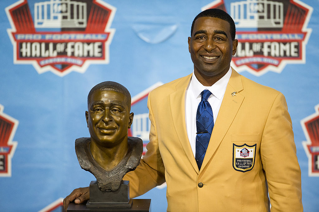 CANTON, OH - AUGUST 3: Former receiver Cris Carter of the Minnesota Vikings poses with his bust during the NFL Class of 2013 Enshrinement Ceremony at Fawcett Stadium on Aug. 3, 2013 in Canton, Ohio.
