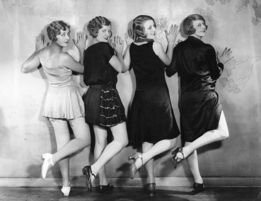 A line of four chorus girls