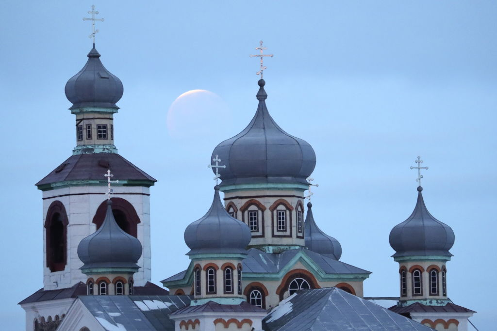 A lunar eclipse is captured over a church in Belarus