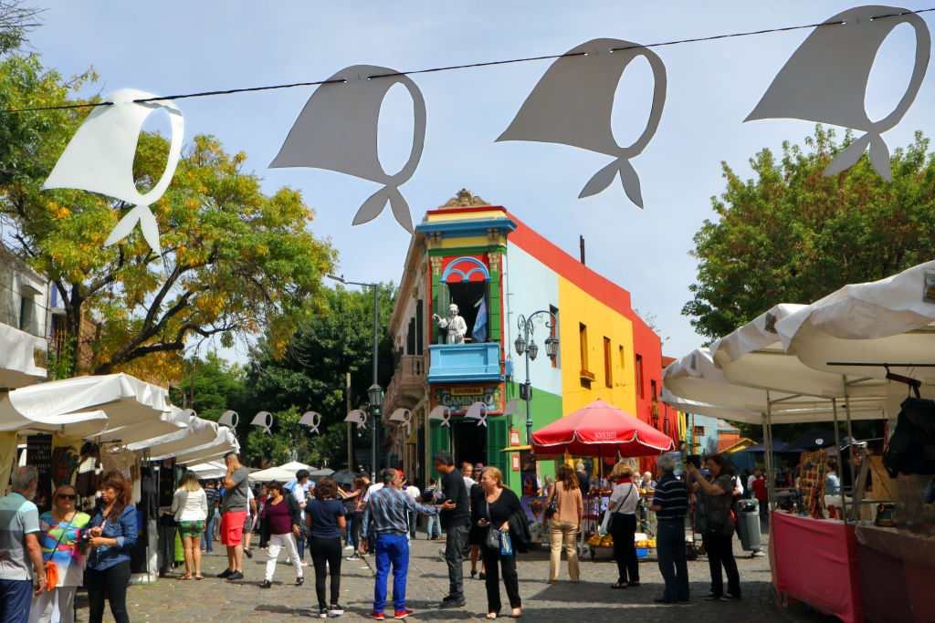 A colorful building and surrounding people are pictured at a street museum in Buenos Aires