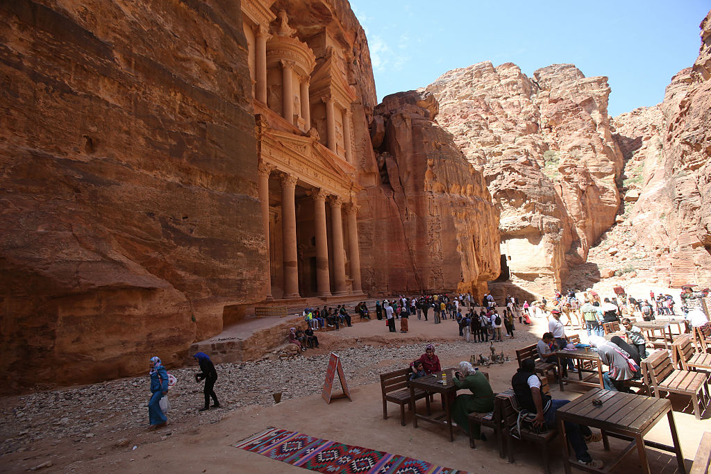 Tourists view the archeological site of Petra in Jordan