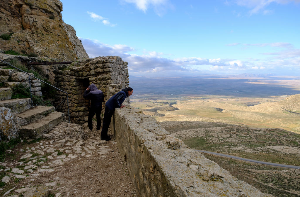 A man overlooks the incredible views from the mountain Jugurtha Tableland in Tunisia