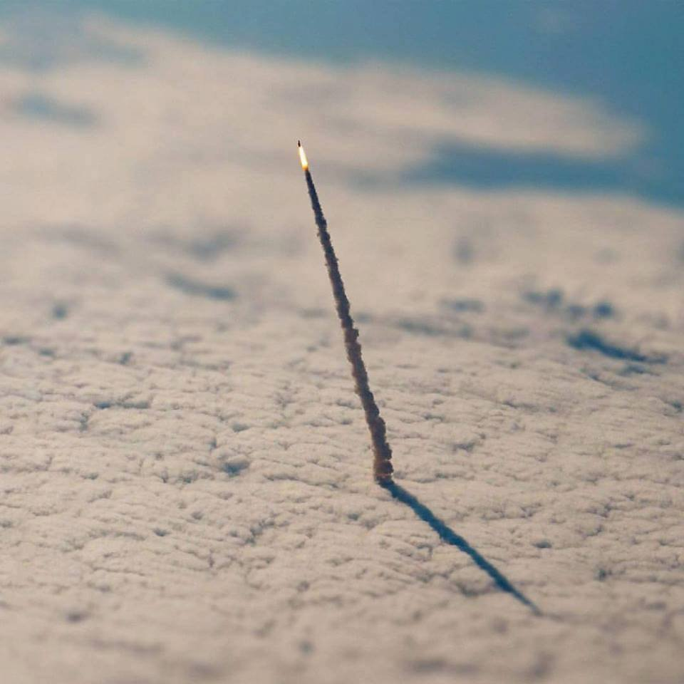 space shuttle launching taken from space