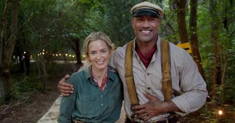 Emily Blunt and Dwayne Johnson pose in their Jungle Cruise costues