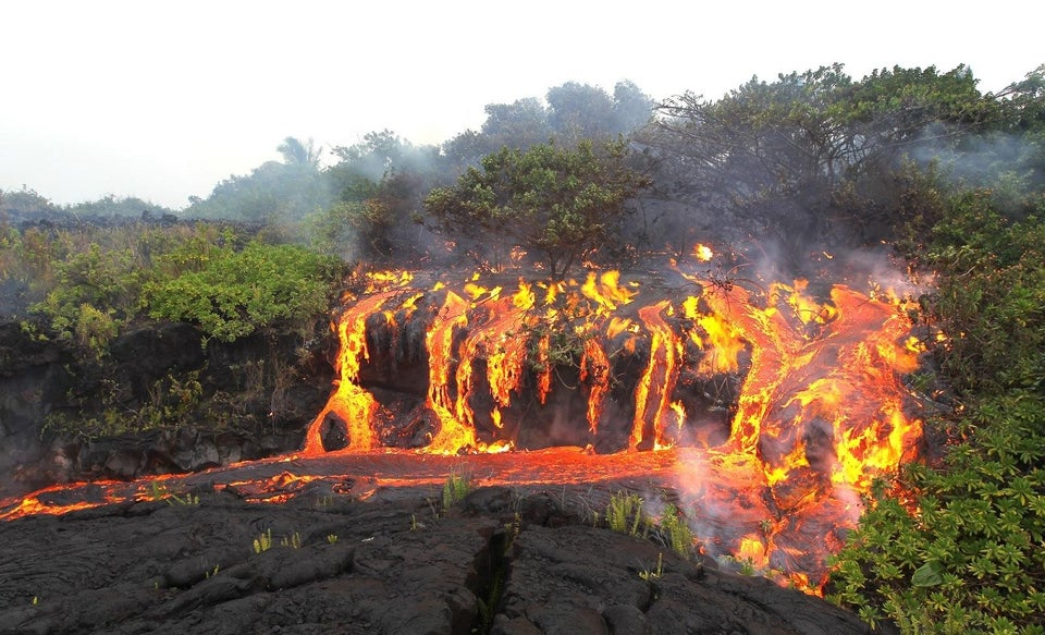 lava flowing over land to look like a waterfall
