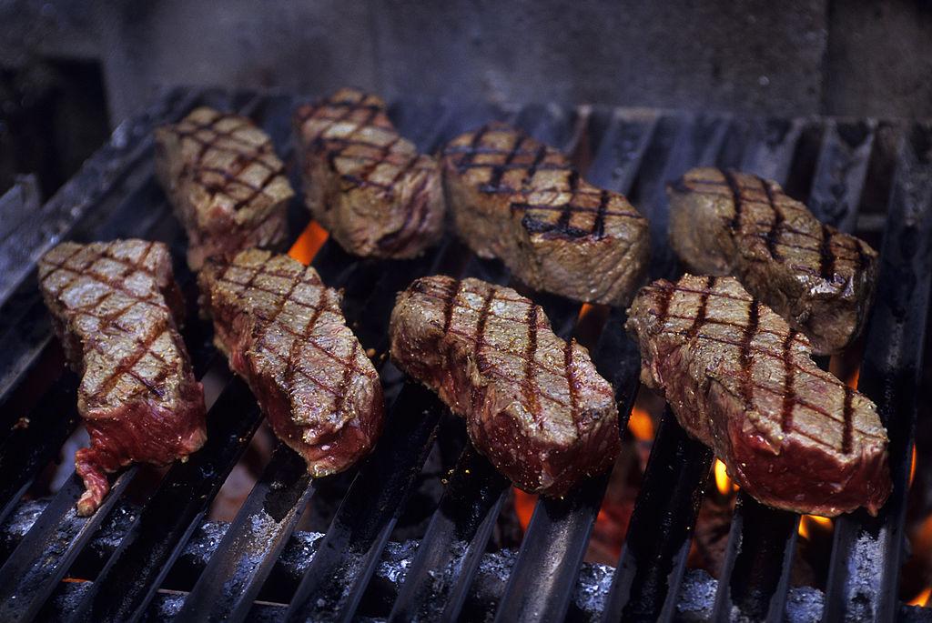 eight steaks on bbq