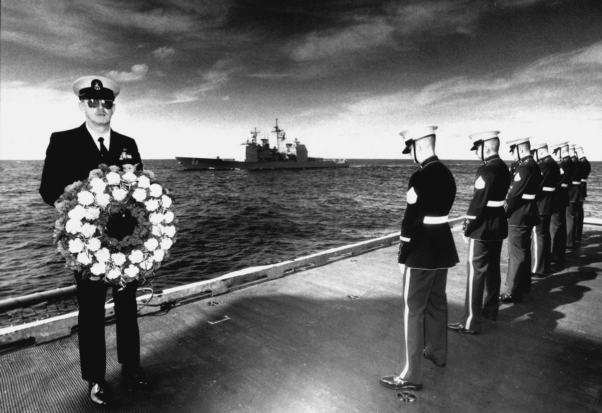 Senior Chief Master Jim Harnes (L) attends a service to commemorate the battle of the coral sea, 1992.
