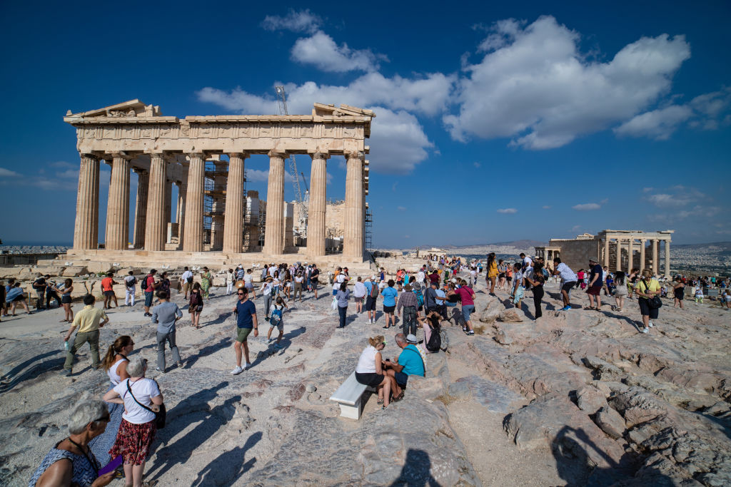 Tourists visit the Parthenon in Greece.