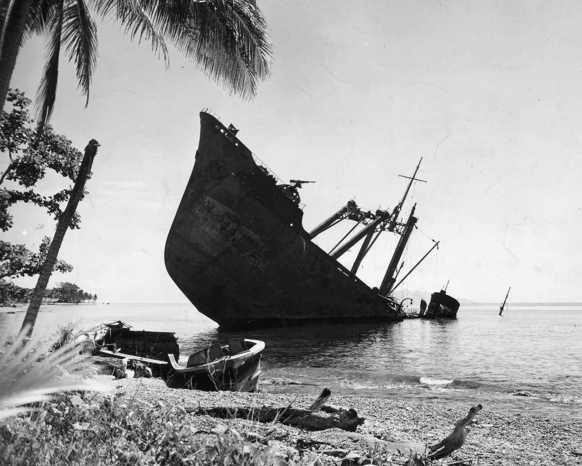 A Japanese naval vessel lies half-submerged offshore, sunk by the U.S. Navy in the battles at Guadalcanal, Solomon Islands, 1942.
