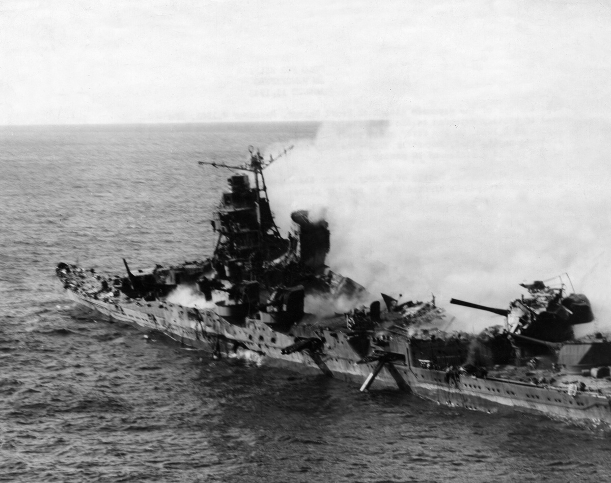 The badly hit Japanese cruiser 'Mikuma' is on fire during the 1942 Battle of Midway.