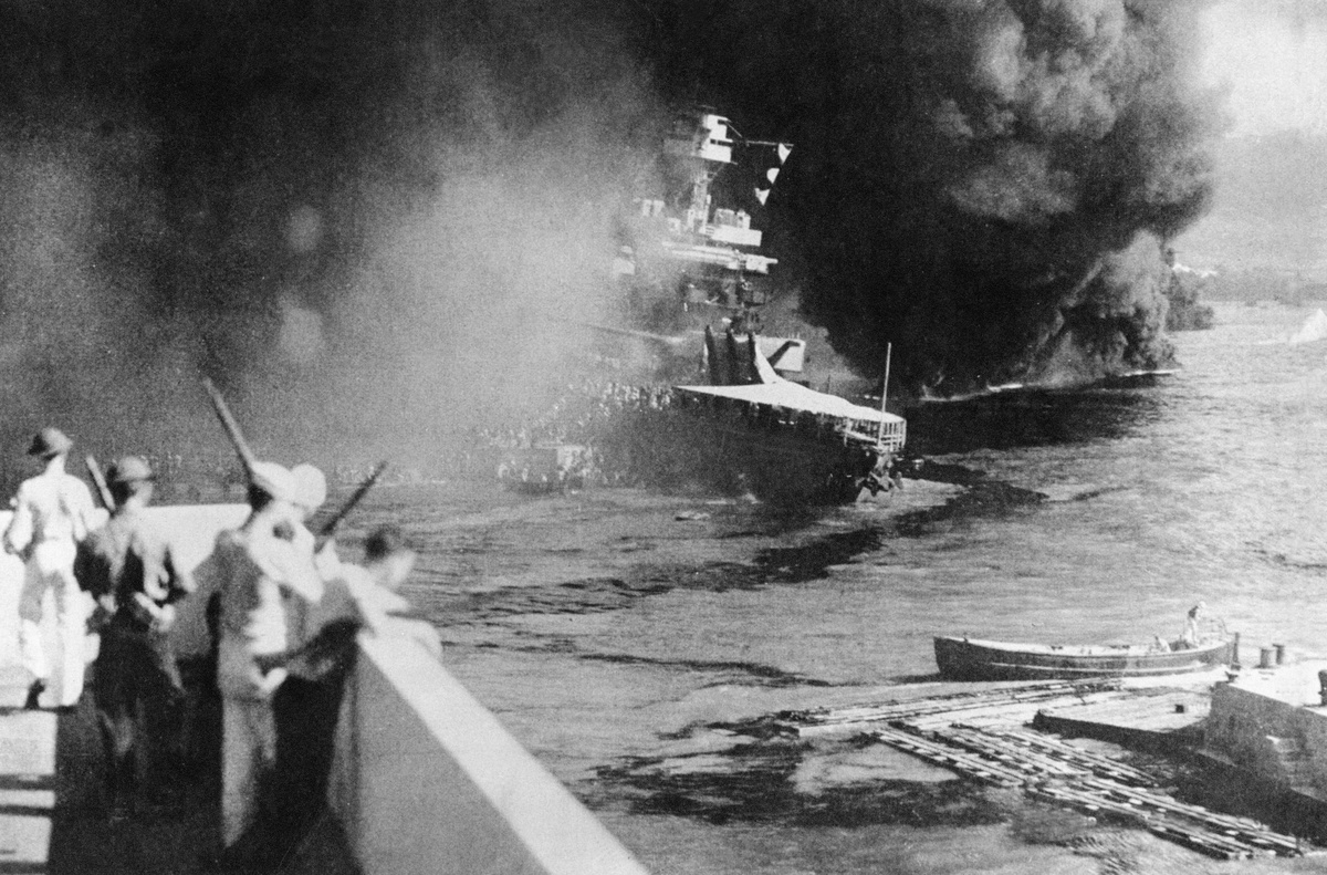 An American ship is bombed during Pearl Harbor, 1941.