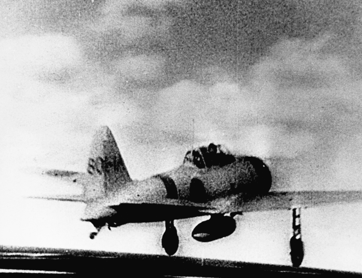 A Japanese Mitsubishi A6M Zero-Sen fighter aircraft takes off to participate in the Battle of Midway.