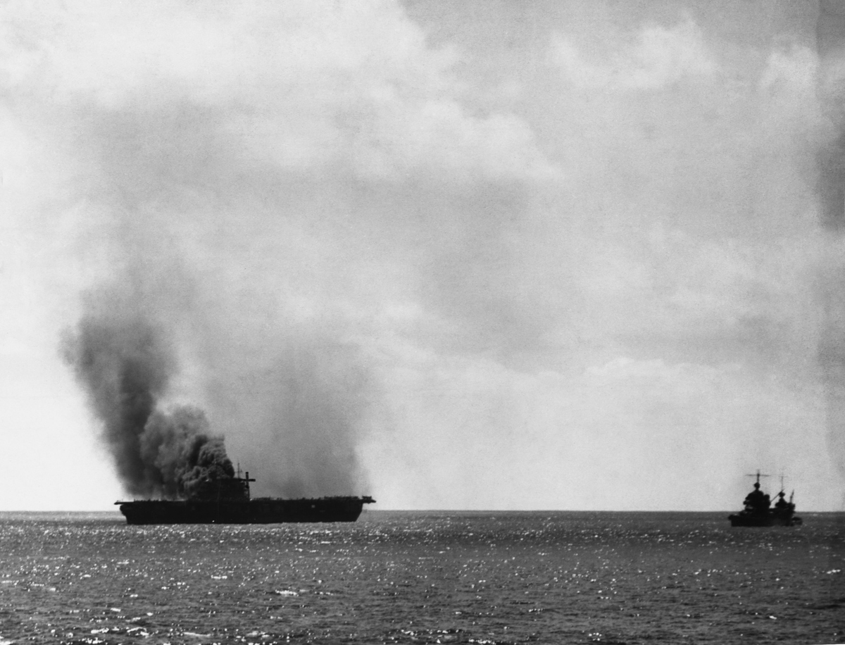 The Yorktown is damaged heavily by Japanese aircraft  on June 4, 1942 in the Battle of Midway.