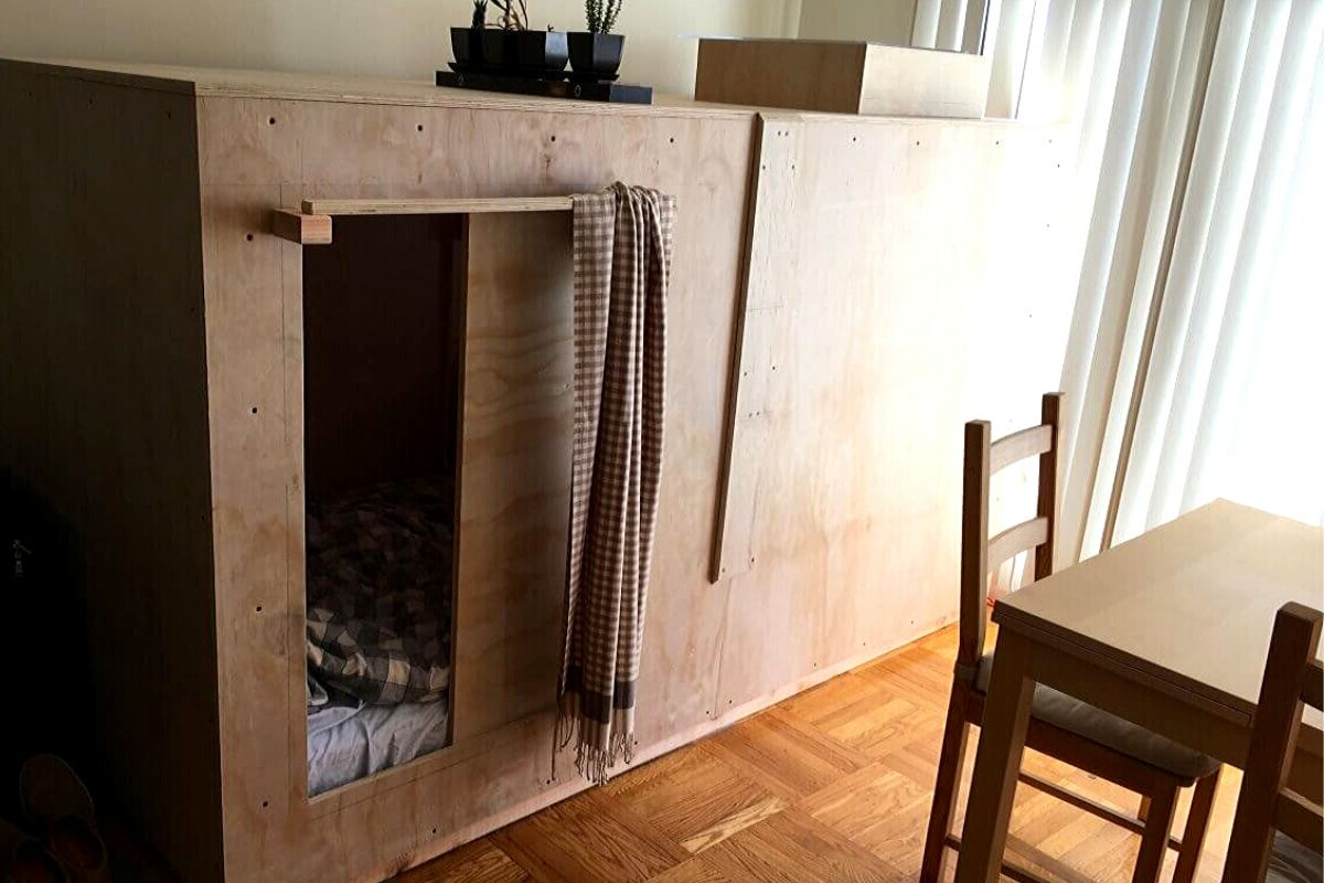 wooden crate in dining room to sleep in