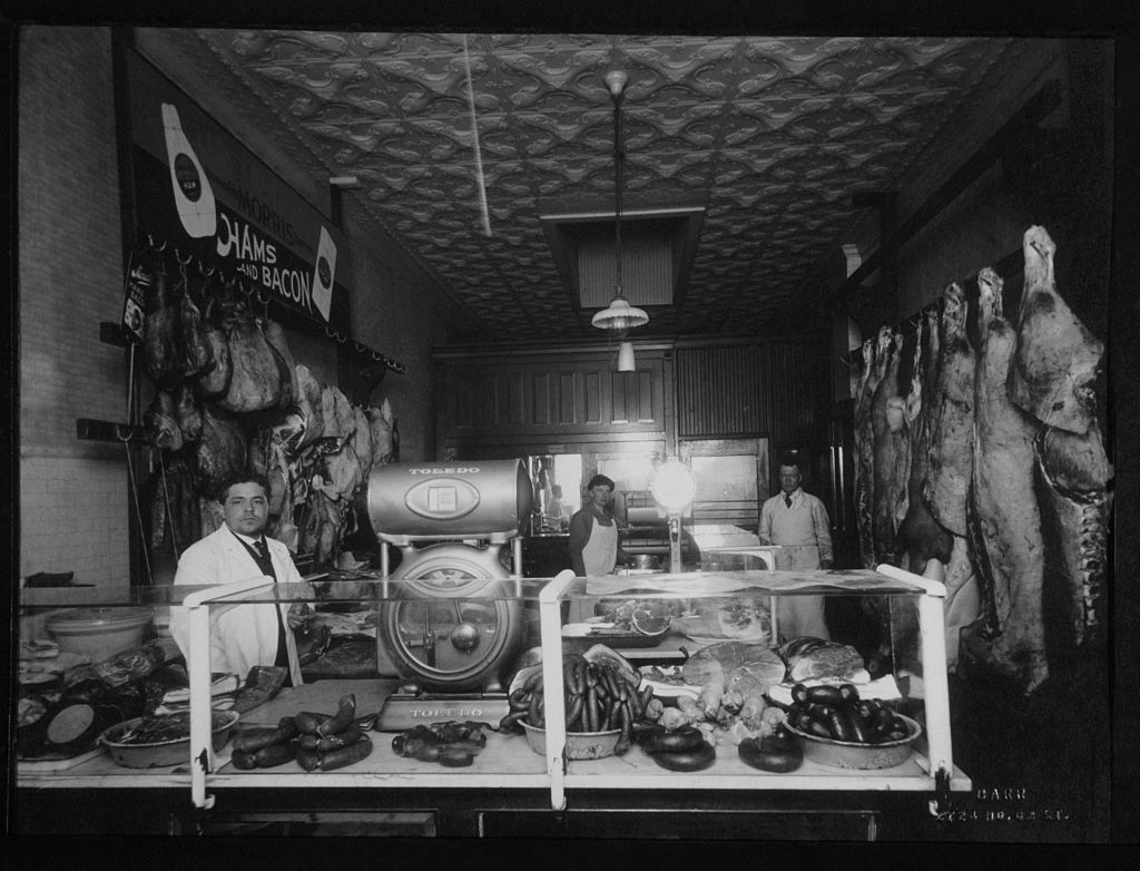 Men working in butchers shop
