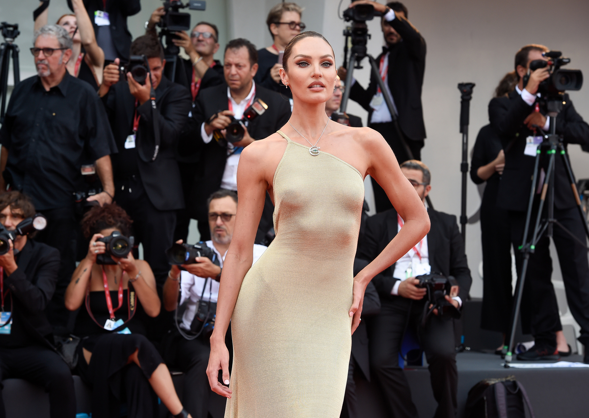 Candice Swanepoel wears a jersey dress at the Venice International Film Festival.