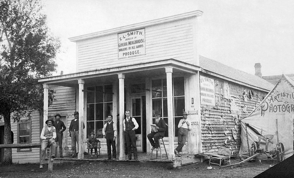 Men standing outside of general store