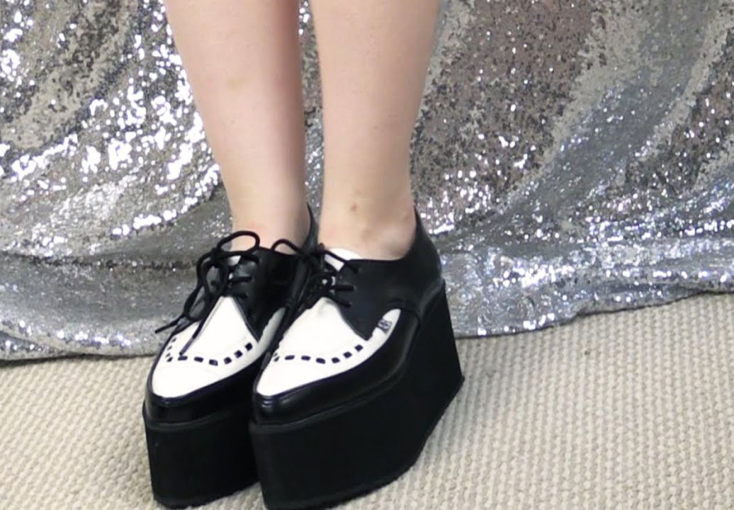 A YouTuber wears tuxedo-style creepers.