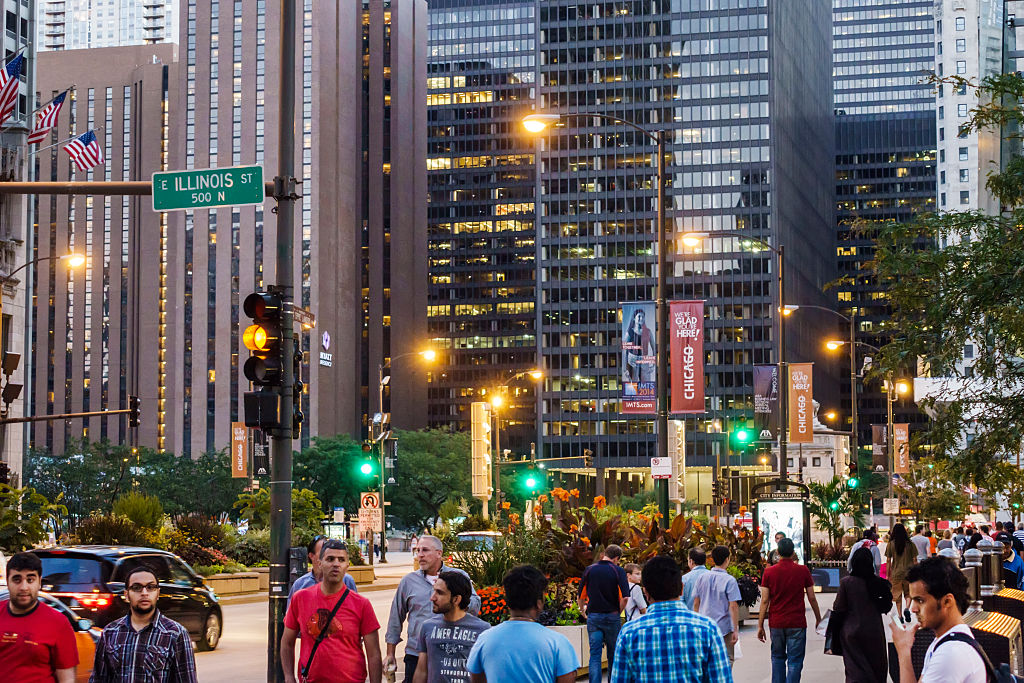 people walking along the magnificent mile during sun down