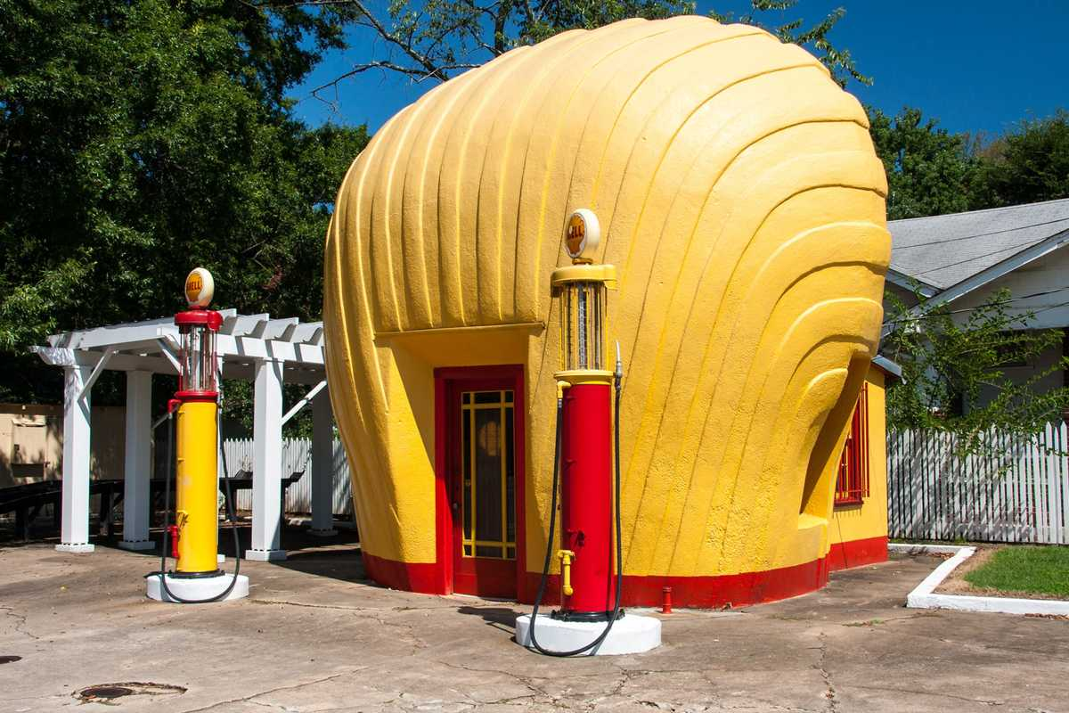 a gas station in the shape of a yellow shell