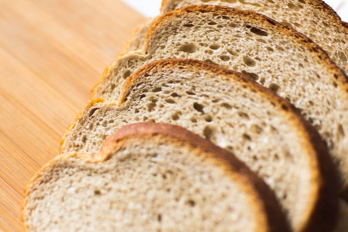 Slices of whole wheat bread are seen.