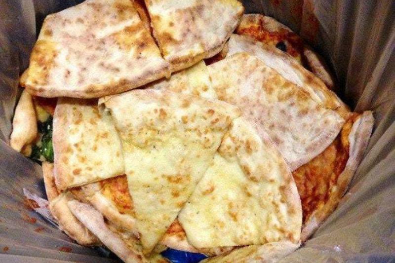 pizza in trash