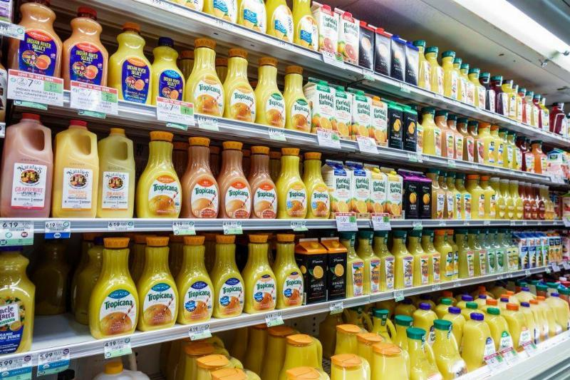 orange juice lined up in a grocery store