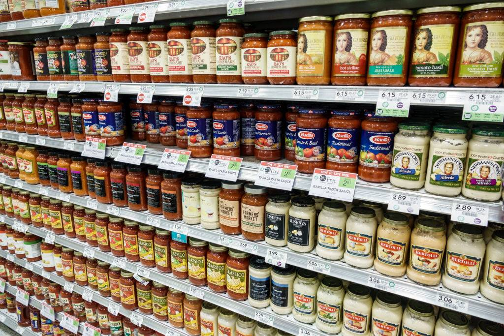 tomato sauce displayed on grocery store shelves