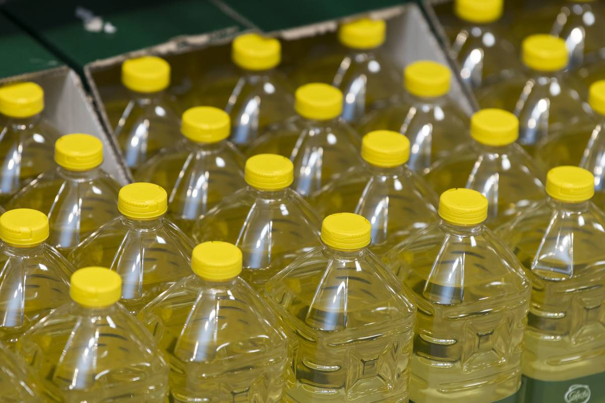 Bottles of vegetable oil are seen on sale.