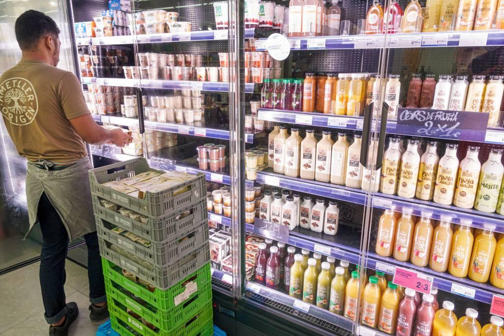 organic market dairy aisle, stocking