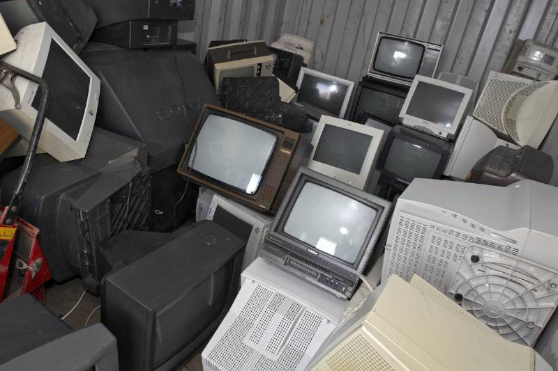 Unwanted televisions lie in a giant pile.