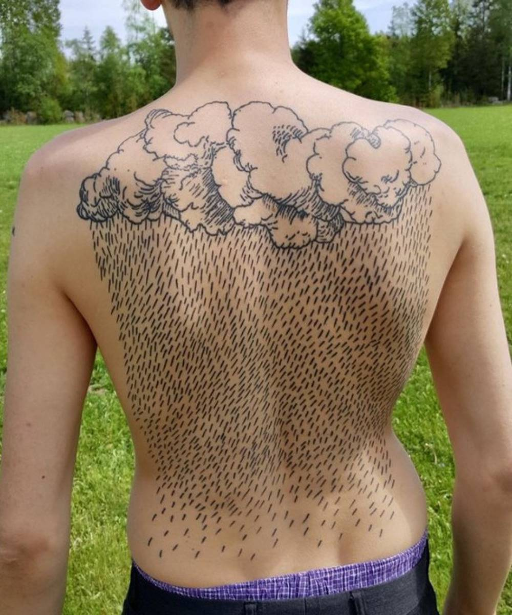 back tattoo of clouds and rain