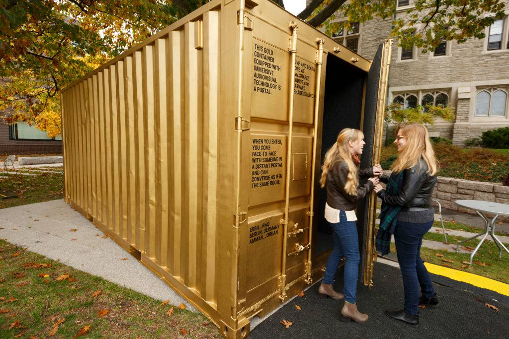 Girls by a shipping container