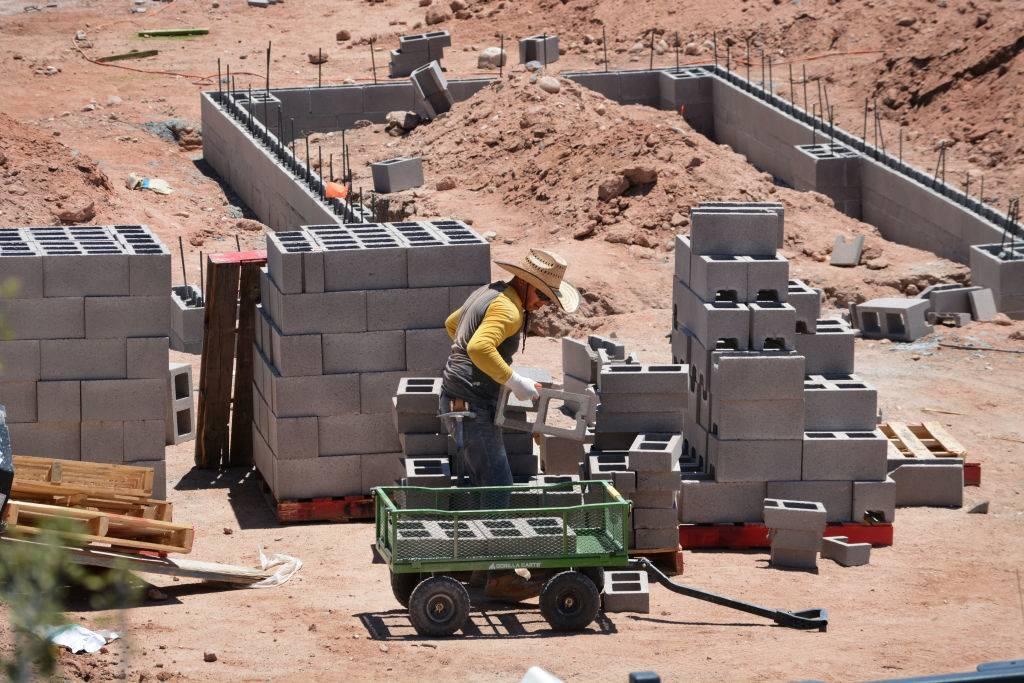 Man working with cinder blocks