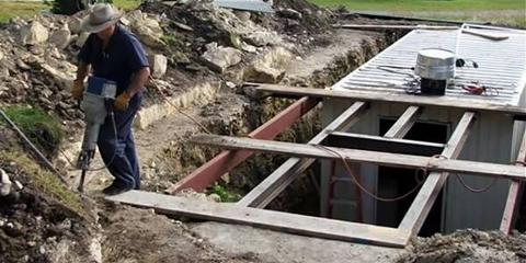 Wayne digging a hole