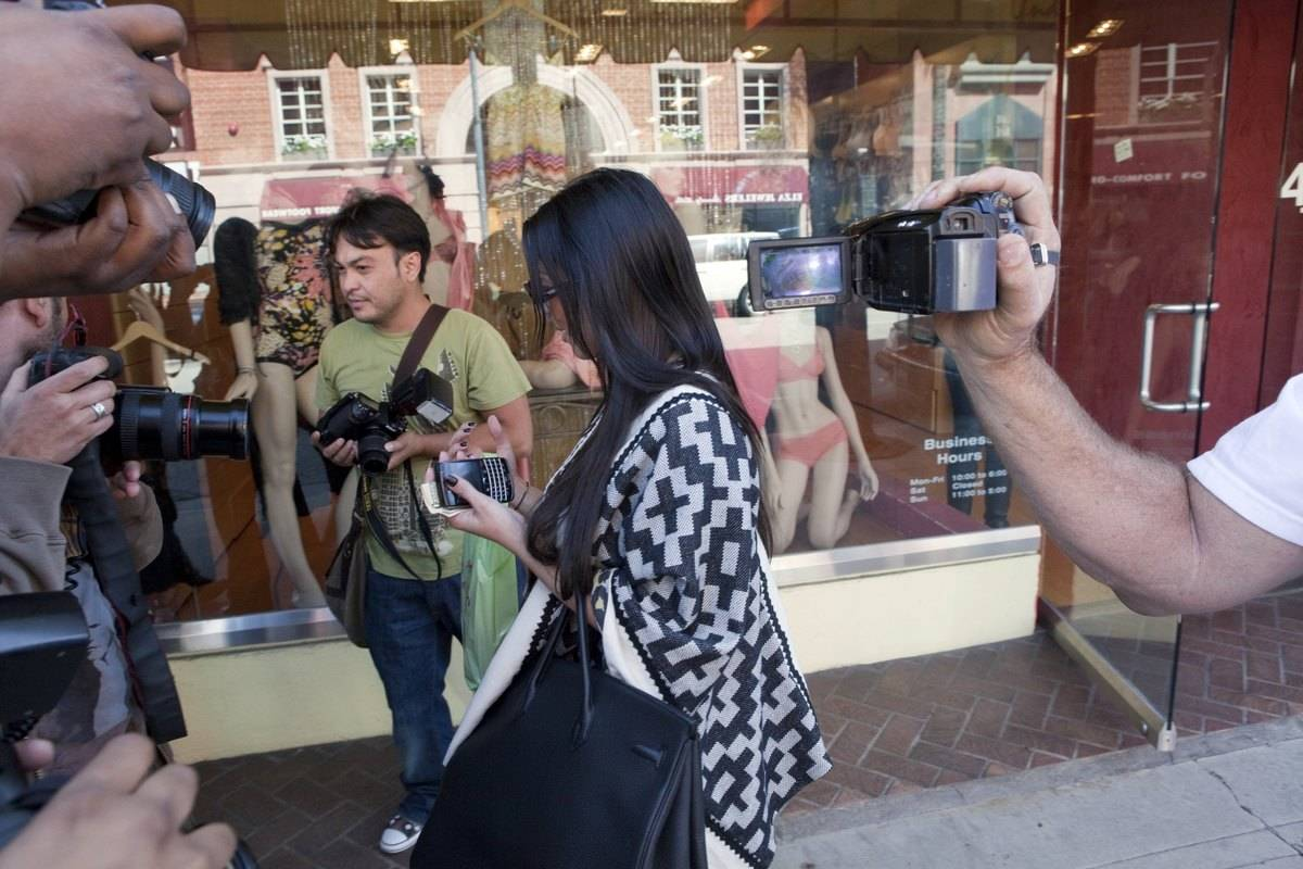 paparazzi surrounding kim kardashian in beverly hills