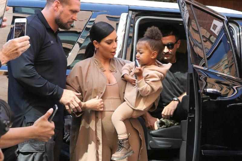 kim and north getting out of car with body guard