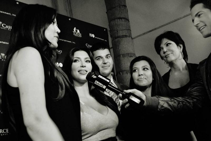 khloe, kim, rob, and kourtney kardashian with kris jenner giving interview