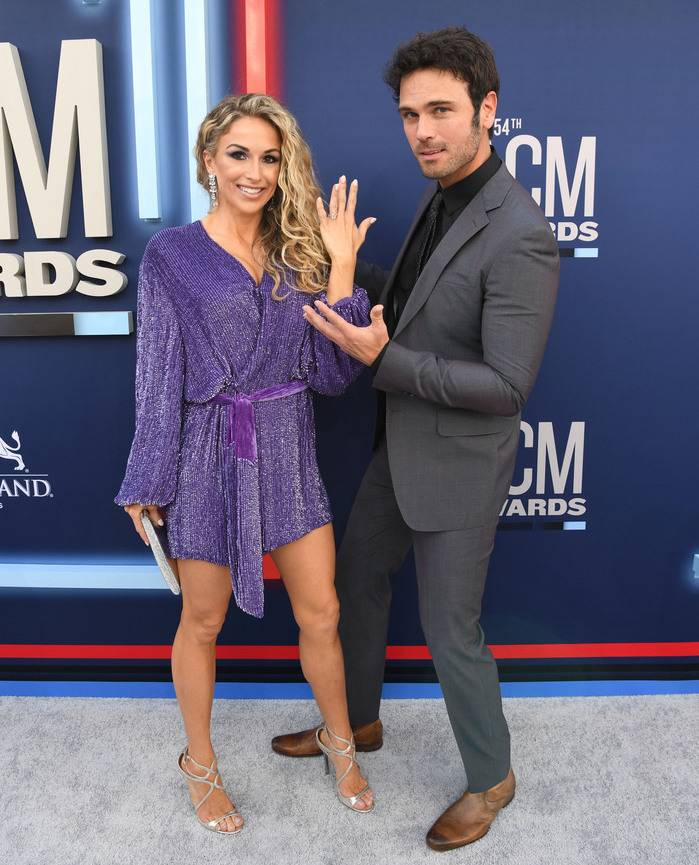 Kasi Williams shows off her wedding ring with her husband, Chuck Wicks, on the ACM 2019 red carpet.