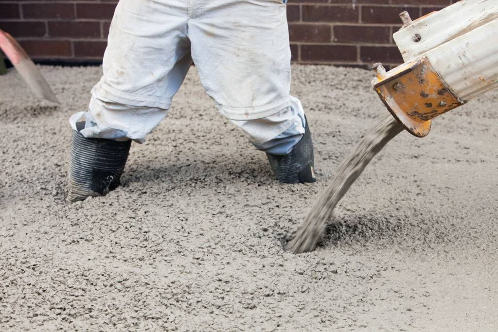 Men pouring concrete