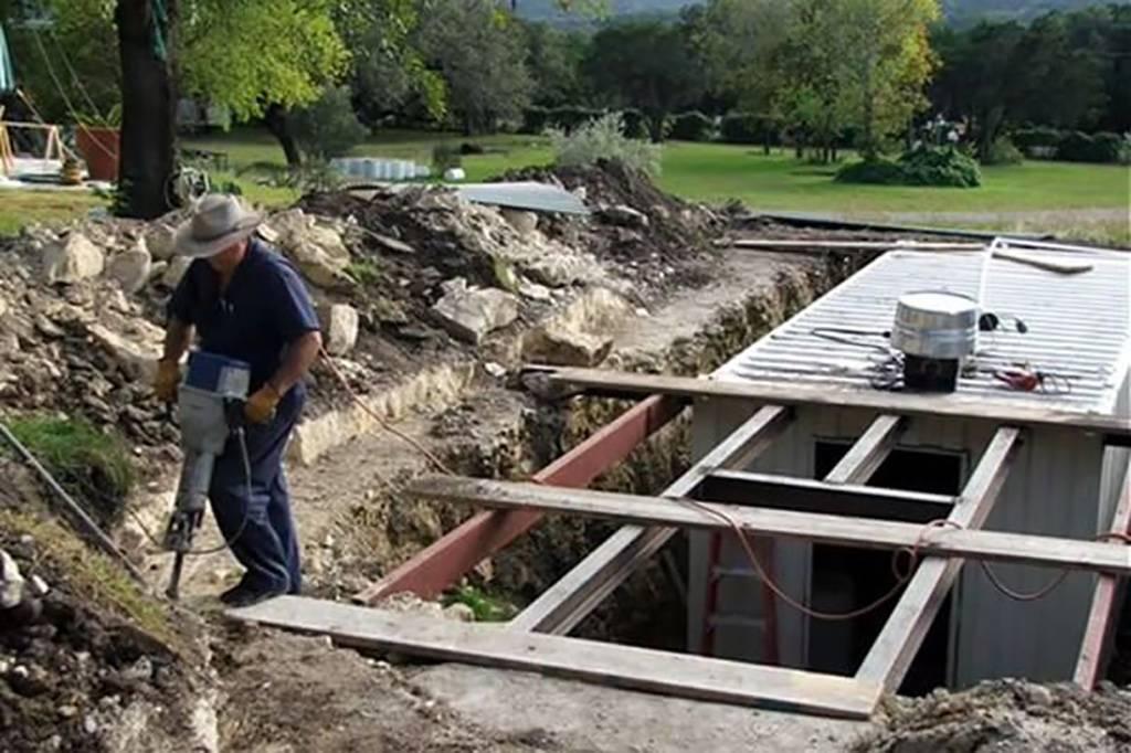 Wayne building a roof