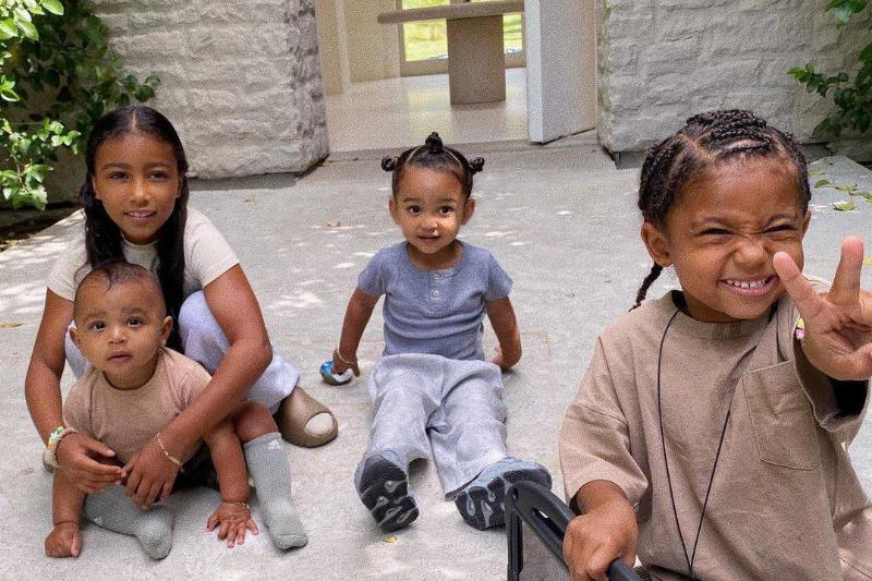 kim kardashian's four kids north, saint, chicago and psalm at home