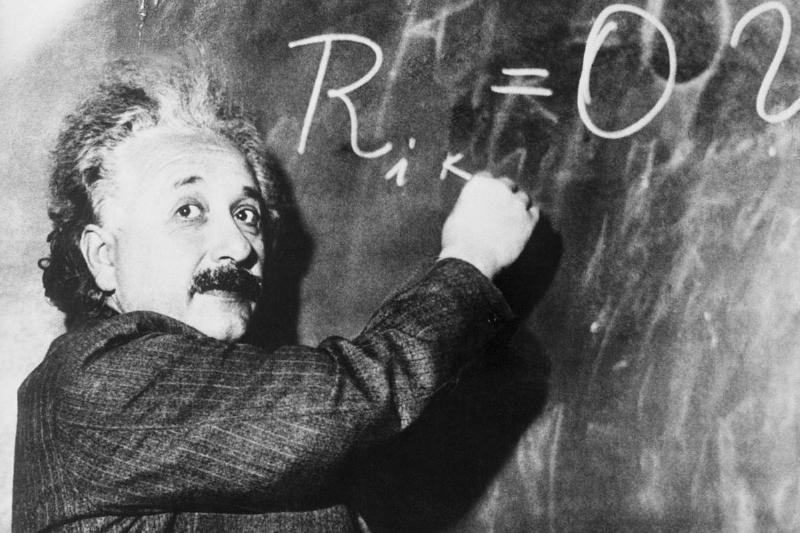 Einstein Writing Equation on Blackboard